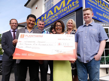 Planitherm Competition winner Winsome Dalley receives her cashback cheque from Bahama boss Paul Pixley