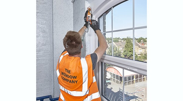 TWC209 Tom Millar of The Window Company (Contracts) demonstrating attention to detail installing arched head windows at Eldon Primary School