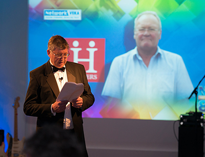 John Ogilvie, Managing Director of Network VEKA announces a special retirement presentation to Malcolm Heaver at the UK installer network's recent AGM.