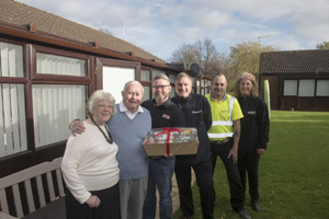 Barbara and Bill Curwen (Willow Park residents) receiving hamper from Ian Goode (Trade Window andDoor Centre), Neil Selby (Safechoice) and Alan Murray and Linda Harrison (McKnight and Son Builders