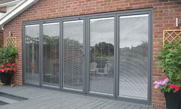 SOLAR-SHADING SOLUTIONS FOR BI-FOLDING DOORS FROM SUNBELL