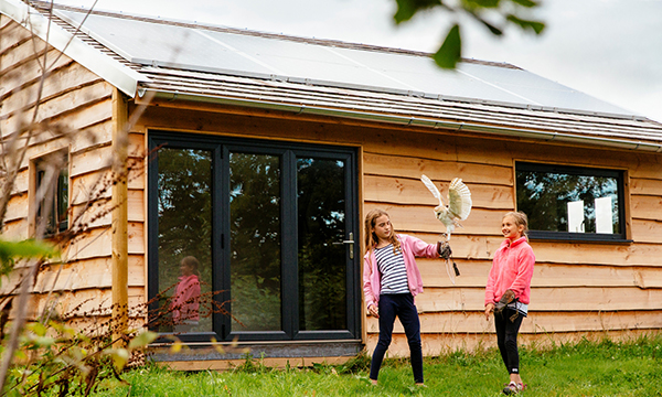 Bi-fold doors let in more light and children at Cornish eco-camp
