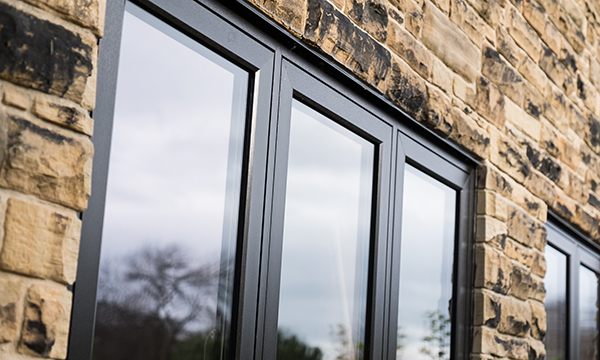 ADM WINDOWS USES SPECTUS FLUSH CASEMENT WINDOWS TO RECREATE TRADITIONAL AESTHETICS IN A FARMHOUSE