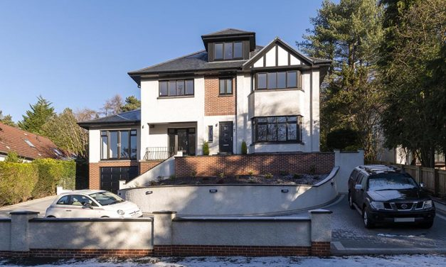 PROPERTY GIVEN NEW LOOK WITH BLACK REHAU PROFILES